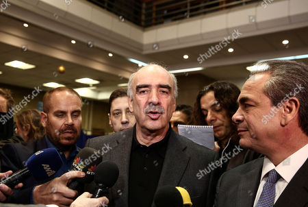 Candidate Vangelis Meimarakis, center, makes statements inside a polling station in Athens, on . Greece's conservative New Democracy party conducts a nationwide voting to elect a new leader