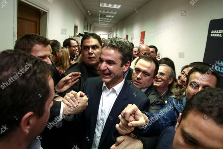 Kyriakos Mitsotakis Newly-elected President of the New Democracy party Kyriakos Mitsotakis, center, is cheered by supporters outside his office in Athens, . Greece's conservative opposition New Democracy party has elected the reformist as its new leader. Former administrative reform minister Mitsotakis has defeated party stalwart Evangelos Meimarakis in a leadership contest open to all party members
