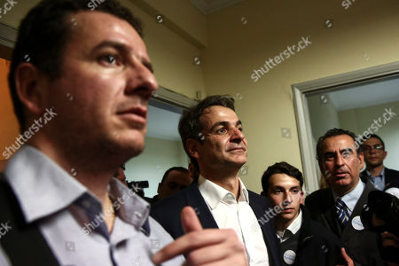 Kyriakos Mitsotakis Newly-elected President of the New Democracy party Kyriakos Mitsotakis, center, listens to associates outside his office in Athens, . Greece's conservative opposition New Democracy party has elected the reformist as its new leader. Former administrative reform minister Mitsotakis has defeated party stalwart Evangelos Meimarakis in a leadership contest open to all party members