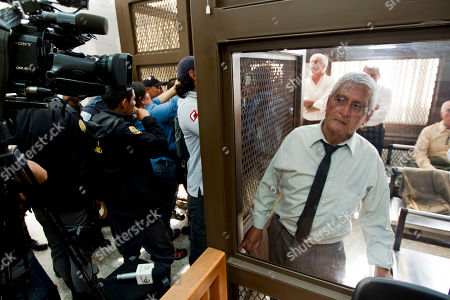 Stock Image of Carlos Humberto Rodriguez Lopez Former Army colonel Carlos Humberto Rodriguez Lopez, photographed through a window, looks out of a cell during his first hearing at a courtroom in Guatemala City, . Prosecutors arrested Rodriguez Lopez and more than a dozen former military and government officials for alleged crimes against humanity committed during Guatemala's civil war