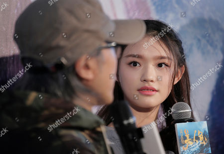 """Lin Yun Chinese actress Lin Yun looks at Hong Kong director Stephen Chow during a promotional event for her new film """"Mermaid"""" in Hong Kong"""