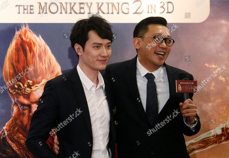 """Feng Shaofeng, Cheang Pou-soi Chinese actor Feng Shaofeng, left, and Hong Kong director Cheang Pou-soi pose for photographers at the premiere of their movie """"The Monkey King 2"""" in Hong Kong"""