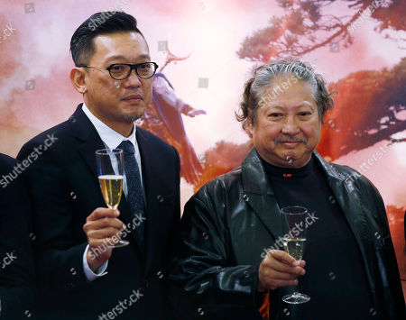 """Cheang Pou-soi, Sammo Hung Hong Kong director Cheang Pou-soi, left, and action director Sammo Hung, pose for photographers at the premiere of their movie """"The Monkey King 2"""" in Hong Kong"""