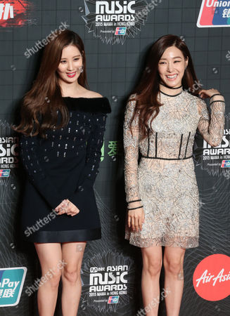 Seohyun, Tiffany South Korean singers Seohyun, left, and Tiffany pose for the photographers on the red carpet of the 2015 Mnet Asian Music Awards (MAMA) in Hong Kong