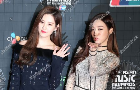 Seohyun, Tiffany South Korean singer Seohyun, left, and Tiffany pose for the photographers on the red carpet of the 2015 Mnet Asian Music Awards (MAMA) in Hong Kong