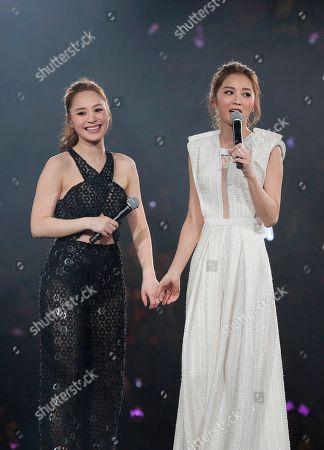 Gillian Chung, Charlene Choi Singers and actresses, Gillian Chung, left, and Charlene Choi, of Hong Kong pop duo Twins perform during their concert in Hong Kong