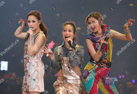 Gillian Chung, Charlene Choi, Joey Yung Singers and actresses Gillian Chung, left, and Charlene Choi, right, of Hong Kong pop duo Twins and singer Joey Yung, center, perform during their concert in Hong Kong