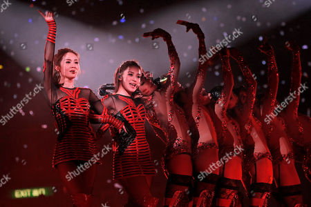 Gillian Chung, Charlene Choi Singers and actresses Gillian Chung, second right, and Charlene Choi, left, of Hong Kong pop duo Twins perform during their concert in Hong Kong