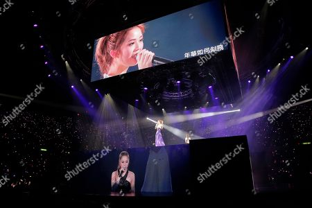 Gillian Chung, Charlene Choi Singers and actresses, Charlene Choi, left, and Gillian Chung, of Hong Kong pop duo Twins perform during their concert in Hong Kong as images of Choi, top, and Chung, bottom, are shown on the screens