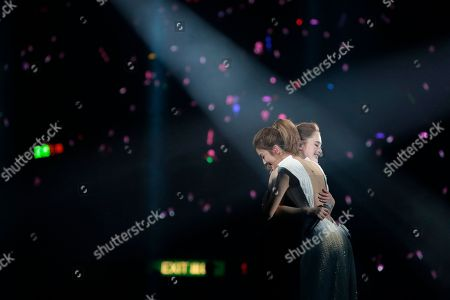 Gillian Chung, Charlene Choi Singers and actresses, Gillian Chung, right, and Charlene Choi, of Hong Kong pop duo Twins hug each other during their concert in Hong Kong