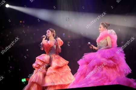 Stock Picture of Gillian Chung, Charlene Choi Singers and actresses, Gillian Chung, right, and Charlene Choi, of Hong Kong pop duo Twins perform during their concert in Hong Kong