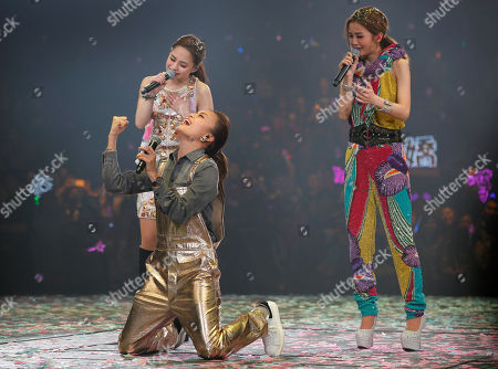 Gillian Chung, Charlene Choi, Joey Yung Singers and actresses Gillian Chung, left, and Charlene Choi, right, of Hong Kong pop duo Twins and singer Joey Yung, front, perform during their concert in Hong Kong