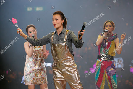 Gillian Chung, Charlene Choi, Joey Yung Singer Joey Yung, front, and Hong Kong pop duo Twins, Gillian Chung, left, and Charlene Choi, right, perform during their concert in Hong Kong