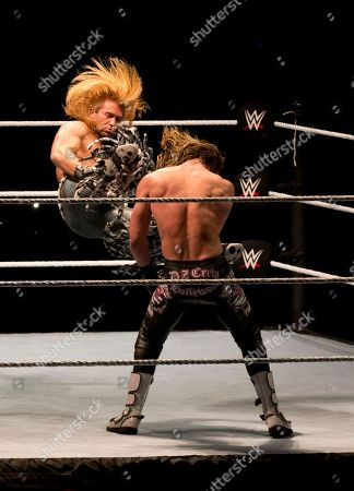 Stock Image of Tyler Breeze, Dolph Ziggler WWE wrestler Tyler Breeze, left, kicks Dolph Ziggler during WWE Live India Tour, in New Delhi, . WWE returned to Indian after a gap of 13 years to entertain their fans