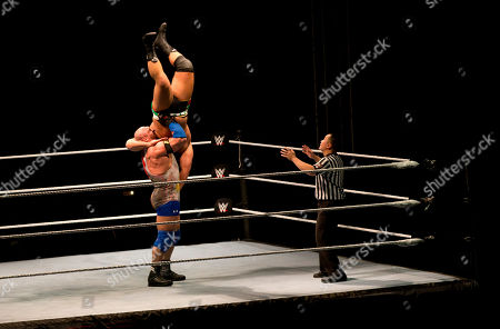 Alexander Rusev, Ryback WWE wrestler Ryback, right, lifts his opponent Alexander Rusev, top, during WWE Live India Tour, in New Delhi, . WWE returned to Indian after a gap of 13 years to entertain their fans