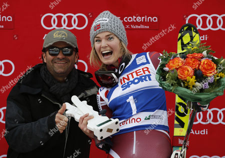Norway's Nina Loeseth celebrates on podium with former ski great Alberto Tomba after winning an alpine ski, women's World Cup slalom, in Santa Caterina, Italy