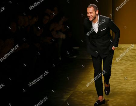 On, Italian Fashion designer Massimiliano Giornetti acknowledges the applause of the audience at the end of the Salvatore Ferragamo men's Fall-Winter 2016-2017 show unveiled in Milan, Italy. Salvatore Ferragamo's creative director, Massimiliano Giornetti, is leaving the fashion house after 16 years. Giornetti entered Ferragamo in 2000 as menswear designer and in 2011 became the brand's creative director