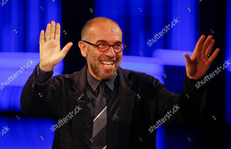 """Italian movie director Giuseppe Tornatore British singer and song writer Holly Lapsley attends the Italian State RAI TV program """"Che Tempo che Fa"""", in Milan, Italy"""