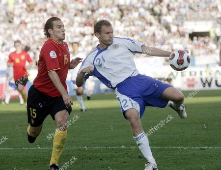 Belgium's Mark De Man (L) and Finland's Jonatan Johansson fight for the ball during the Euro 2008 Group A qualifying match.