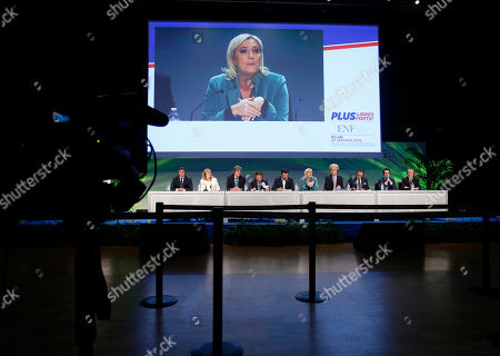 From left: Romania's Laurentiu Rebega, Britain's Janice Atkinson, Dutch Marcel De Graaf, Japan's Tomio Okamura, Italy's Northern League leader Matteo Salvini, French National Front president Marine Le Pen, Firebrand Dutch lawmaker Geert Wilders, Austria's Heinz Christian Strache, Holland's Marcel De Graaf and Poland's Michal Marusik attend the press conference of the second day of a 2-day convention of European nationalists, in Milan, Italy, . The rally is being billed by organizers as the first congress of the Europe of Nations and Freedom group within the European Parliament, which was formed last year