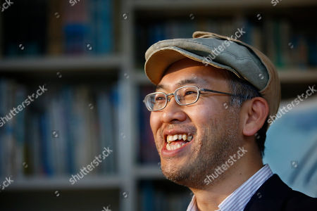 """Stock Picture of Hiromasa Yonebayashi Japanese director Hiromasa Yonebayashi smiles during an interview about his latest film """"When Marnie Was There"""" at his office, Studio Ghibli, in suburban Tokyo. Yonebayashi says the ways his artists have carefully depicted cloudy skies and rippling waves express the soul of the main character, Anna, who nurses a scar in her heart because she is adopted. """"It's a challenge to convey internal emotions visually such as through her facial expressions and the landscape,"""" he said quietly in the interview. """"The wind is cold, but there is warmth in an embrace"""