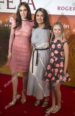 "Sandra EcheverrÌa, Salma Hayek, Loreto Peralta Mexican actress and producer Salma Hayek, center, child actress Loreto Peralta, right, and Mexican actress and singer Sandra Echeverria pose for pictures on the red carpet, promoting their new movie ""The Prophet,"" in Mexico City, . Hayek produced and voices a character in the animated film adaptation of Lebanese writer Kahlil Gibran's 1923 book of prose poetry"
