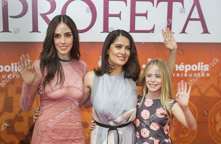 "Sandra Echeverría, Salma Hayek, Loreto Peralta Mexican actress and producer Salma Hayek, center, child actress Loreto Peralta, right, and Mexican actress and singer Sandra Echeverria pose for pictures on the red carpet, promoting their new movie ""The Prophet,"" in Mexico City, . Hayek produced and voices a character in the animated film adaptation of Lebanese writer Kahlil Gibran's 1923 book of prose poetry"