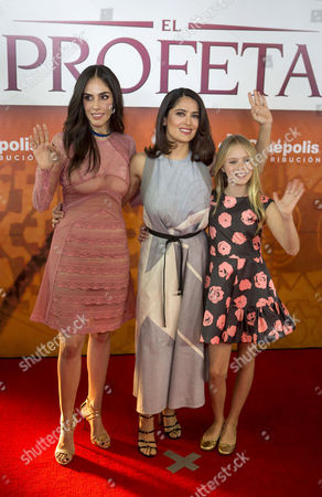 "Sandra Echeverria, Salma Hayek, Loreto Peralta Mexican actress and producer Salma Hayek, center, child actress Loreto Peralta, right, and Mexican actress and singer Sandra Echeverria pose for pictures on the red carpet, promoting their new movie ""The Prophet,"" in Mexico City, . Hayek produced and voices a character in the animated film adaptation of Lebanese writer Kahlil Gibran's 1923 book of prose poetry"