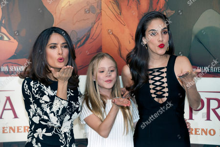 "Salma Hayek, Loreto Peralta, Sandra Echeverría Mexican actress and producer Salma Hayek, from left, child actress Loreto Peralta, and Mexican actress and singer Sandra Echeverría, blow kisses as they pose for pictures during a news conference to promote their movie ""The Prophet,"" in Mexico City, . Hayek produced and voices a character in the animated film adaptation of Lebanese writer Kahlil Gibran's 1923 book of prose poetry"