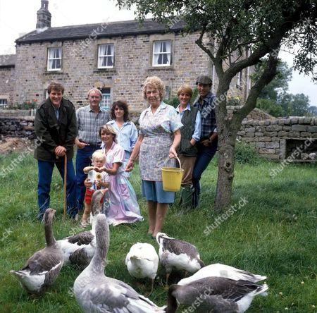 'Emmerdale'  TV - 1985 - Jackie Merrick [Ian Sharrock], Matt Skilbeck [Frederick Pyne], Sandie Merrick [Jane Hutcheson], Annie Sugden [Sheila Mercier], Pat Sugden [Helen Weir], Jack Sugden [Clive Hornby], Sam Skilbeck  [Benjamin Whitehead], Dolly Skilbeck [Jean Rogers] and Annie Sugden [Sheila Mercier] feeding the geese.