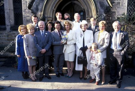 'Emmerdale'  TV - 1989 -  Joe marries Kate Kathy Merrick[Malandra Burrows], Rachel Hughes [Glenda McKay], Jackie Merrick [Ian Sharrock], David Hughes ? [Martin Whitby?], Sandie Merrick {Jane Hutcheson], Joe Sugden [Frazer Hines], Jack Sugden [Clive Hornby with Robert Sugden [Richard Smith?], Kate Hughes [Sally Knyvette], Rev Donald Hinton [Hugh Manning], Annie Sugden [Sheila Mercier], Mark Hughes [Craig McKay] and dolly Skilbeck [Jean Rogers] with Sam Skilbeck [Benjamin Whitehead] and Matt Skilbeck [Frederick Pyne]