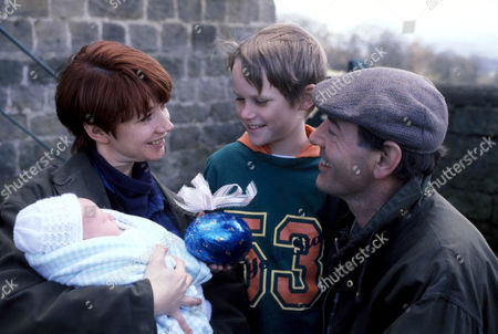Stock Picture of 'Emmerdale'  TV - 1994 Sarah Sugden [Madeleine Howard] and Jack Sugden [Clive Hornby] with son and baby.