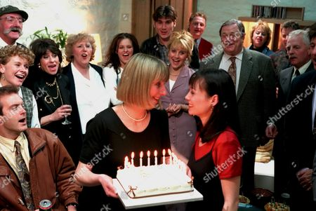 'Emmerdale'  TV - 1995 - Housewarming/Zoe's birthday party Emma Nightingale [Rachel Ambler] and Zoe Tate [Leah Bracknell] celebrate surrounded by: L-R [not counting man with red hair, woman to his left and the man next to her, who may be extras. Chris Tate [Peter Amory]  Rachel Hughes [Glenda McKay] , Seth Armstrong [Stan Richards],Viv Windsor [Deena Payne], Betty Eagleton [Paula Tilbrook], Linda Glover [Tonicha Jeronimo],  Dave Glover, [Ian Kelsey], Kathy Bates [Malandra Burrows], Alan Turner [Richard Thorpe], Eric Pollard [Christopher Chittell] and a glimpse of Frank Tate. [Norman Bowler].