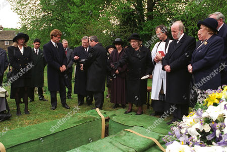 'Emmerdale'  TV - 1995 - Joe Sugden's funeral. Annie Sugden [Sheila Mercier] sprinkles earth on her son's grave. Also pictured: Kim Tate [Claire King] , Frank Tate [Norman Bowler], Alan Turner [Richard Thorp], Sarah Sugden [Alyson Spiro, the vicar [David Hobbs], Amos Brearly [Ronald Magill] and Betty Eagleton [Paula Tilbrook].