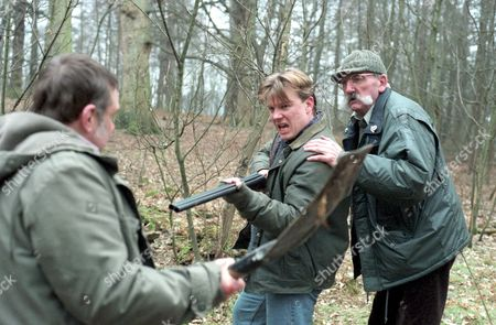 'Emmerdale'  TV -  1996 - Nick challenges poacher Jed Connell [Ian Blower], Nick Bates [Cy Chadwick] with gun and Seth Armstrong [Stan Richards]