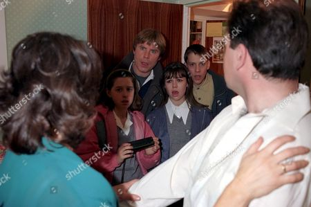 'Emmerdale'  TV - 1996 - Terry and Viv are caught out. Viv Windsor [Deena Payne] and Terry Woods [Billy Hartman], observed by Donna Windsor [Sophie Jeffrey],  Vic Windsor [Alun Lewis], Kelly Windsor [Adele Silva] and Scott Windsor [Toby Cockerell]