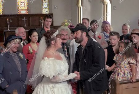 'Emmerdale'  TV - 1997 - Lisa's Wedding Day Lisa Clegg [Jane Cox] almost married Albert Dingle [Bobby Knutt], even though neither of them really wanted to marry. Fortunately Zak Dingle [Steve Halliwell] intervened and proposed to Lisa himself.