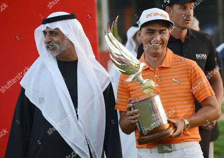 Rickie Fowler Rickie Fowler of the United States poses with the trophy next to Sheikh Nahyan bin Mubarak Al Nahyan, UAE Minister of Culture, Youth and Community Development, after winning the Abu Dhabi Golf Championship in Abu Dhabi, United Arab Emirates