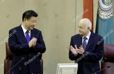 Chinese President Xi Jinping, left, is greeted by Arab League's Secretary-General Nabil Elaraby, during his visit to the Arab League headquarters in Cairo, Egypt