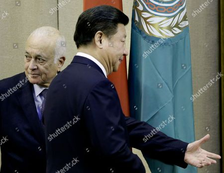 Chinese President Xi Jinping, left, is greeted by Arab League's Secretary-General Nabil Elaraby during his visit to the Arab League headquarters in Cairo, Egypt