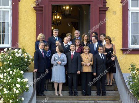 Stock Photo of Front - Tony Blair and wife Cherie, Joachim Sauer, Angela Merkel, Nicolas Sarkozy, middle - Romano Prodi and wife Flavia Franzoni, Vladimir Putin and wife Lyudmila Putina, Jose Manuel Barroso and wife Margarida Sousa, back - Stephen Harper and wife Laureen Harper, Laura Bush, George W Bush, Shinzo Abe and wife Akie Abe