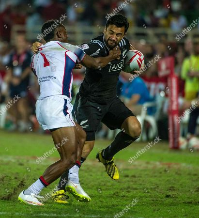Sherwin Stowers, Carlin Isles Sherwin Stowers of News Zealand tries to escape the tackle from Carlin Isles of the US in the third place final of the Sevens World Series rugby tournament in Dubai, United Arab Emirates