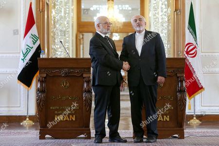 Mohammad Javad Zarif, Ibrahim al-Jafari Iranian Foreign Minister Mohammad Javad Zarif, right, and his Iraqi counterpart Ibrahim al-Jafari shake hands at the conclusion of their press conference, in Tehran, Iran