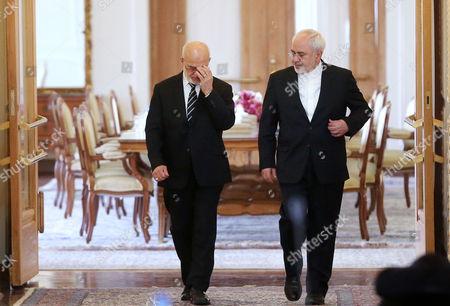 Mohammad Javad Zarif, Ibrahim al-Jafari Iranian Foreign Minister Mohammad Javad Zarif, right, and his Iraqi counterpart Ibrahim al-Jafari make their way to attend a press conference after their talks, in Tehran, Iran
