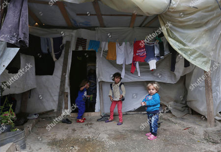 Syrian refugee children stand outside their family tent, during the visit of Canadian Minister of Immigration John McCallum to a camp in the southern town of Ghaziyeh, near the port city of Sidon, Lebanon, . McCallum is on a one-day visit to Lebanon