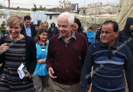John McCallum Canadian Minister of Immigration John McCallum, center, walks during his visit to a Syrian refugee camp in the southern town of Ghaziyeh, near the port city of Sidon, Lebanon