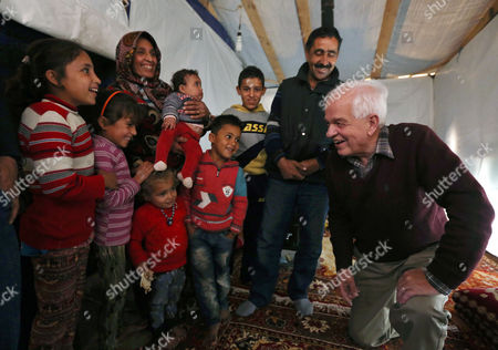 John McCallum Canadian Minister of Immigration John McCallum, right, speaks with a Syrian family inside their tent, during his visit to a refugee camp in the southern town of Ghaziyeh, near the port city of Sidon, Lebanon