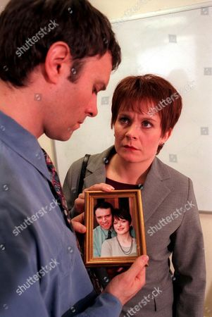 'Emmerdale'  TV - 1999 - Rachel (GLENDA McKAY) questions Graham (KEVIN PALLISTER) about a photograph she has found of his first wife.