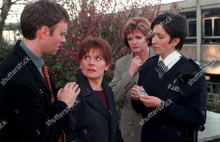 'Emmerdale'  TV - 1999 - Rachel looks at Graham stunned as she is arrested for the possession of illegal substances. Pictured (L-R) Graham (KEVIN PALLISTER), Rachel (GLENDA McKAY), Miss Strickland (ALEX HALL) and Angie (Policewoman) (FREYA COPELAND).