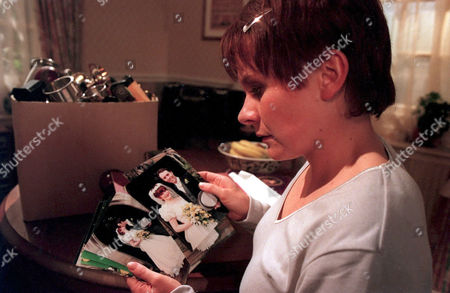 'Emmerdale'  TV - 1999 - Rachel [Glenda McKay] begins to feel trouble as she looks at pictures of Graham's first wife.
